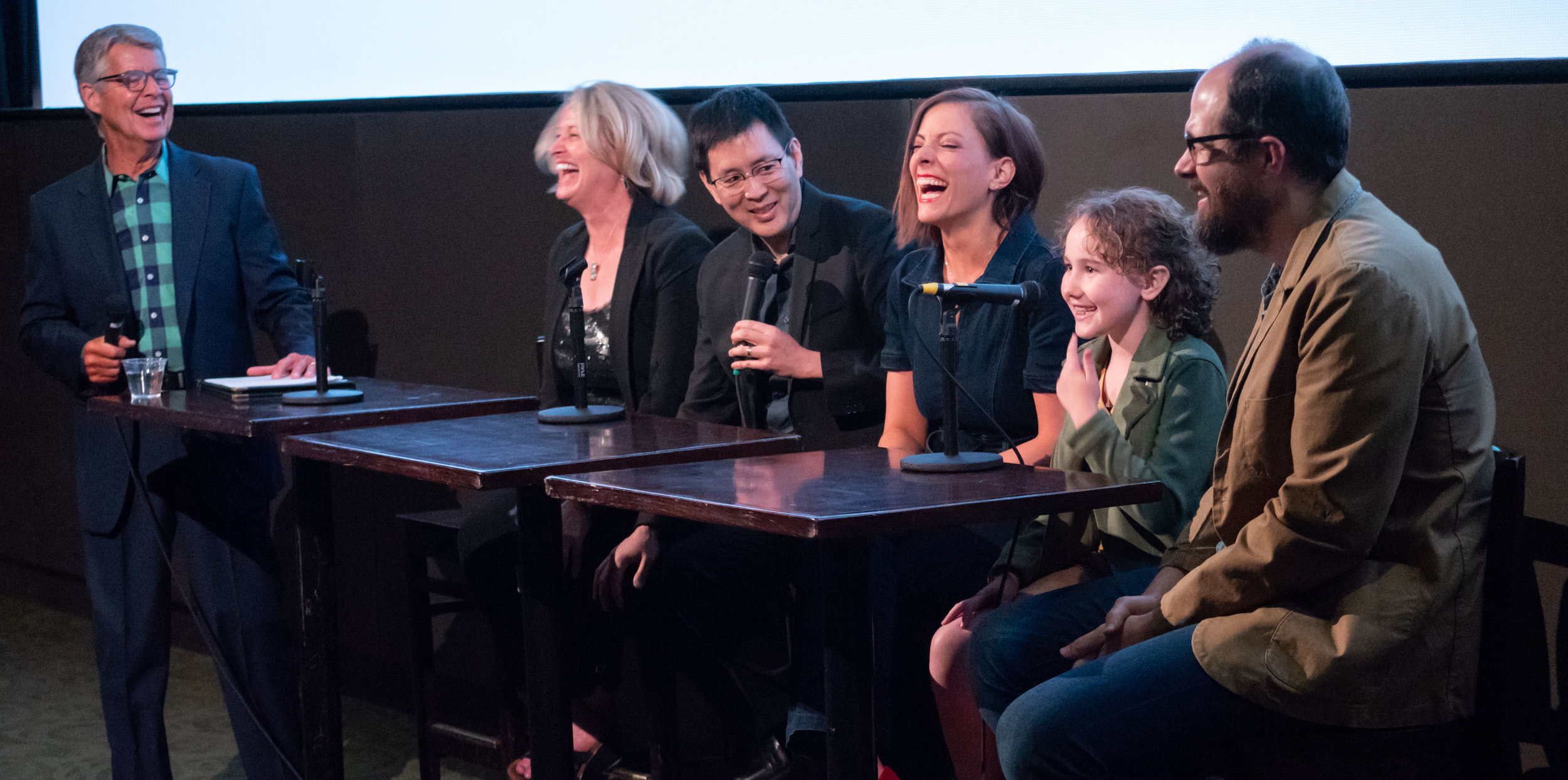 "The cast and directors laugh after lead actor Nev Scharrel tells a story about her time filming ""Remembering Us."" (photo by Glenn Asakawa)"