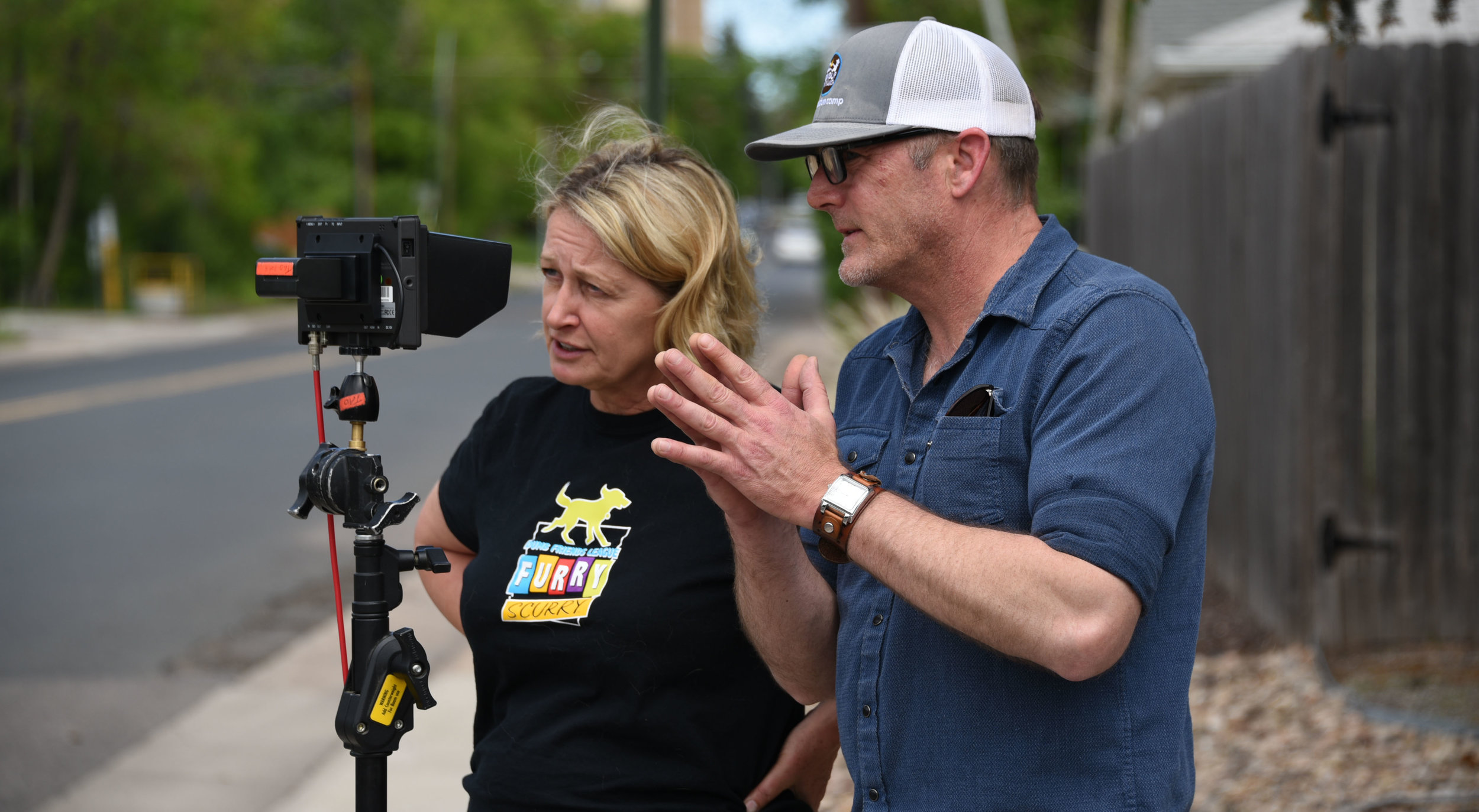 "Writer-director Lori Kay Allred goes over her shot with cinematographer Jeff Pointer in the short film ""Something In Common."""