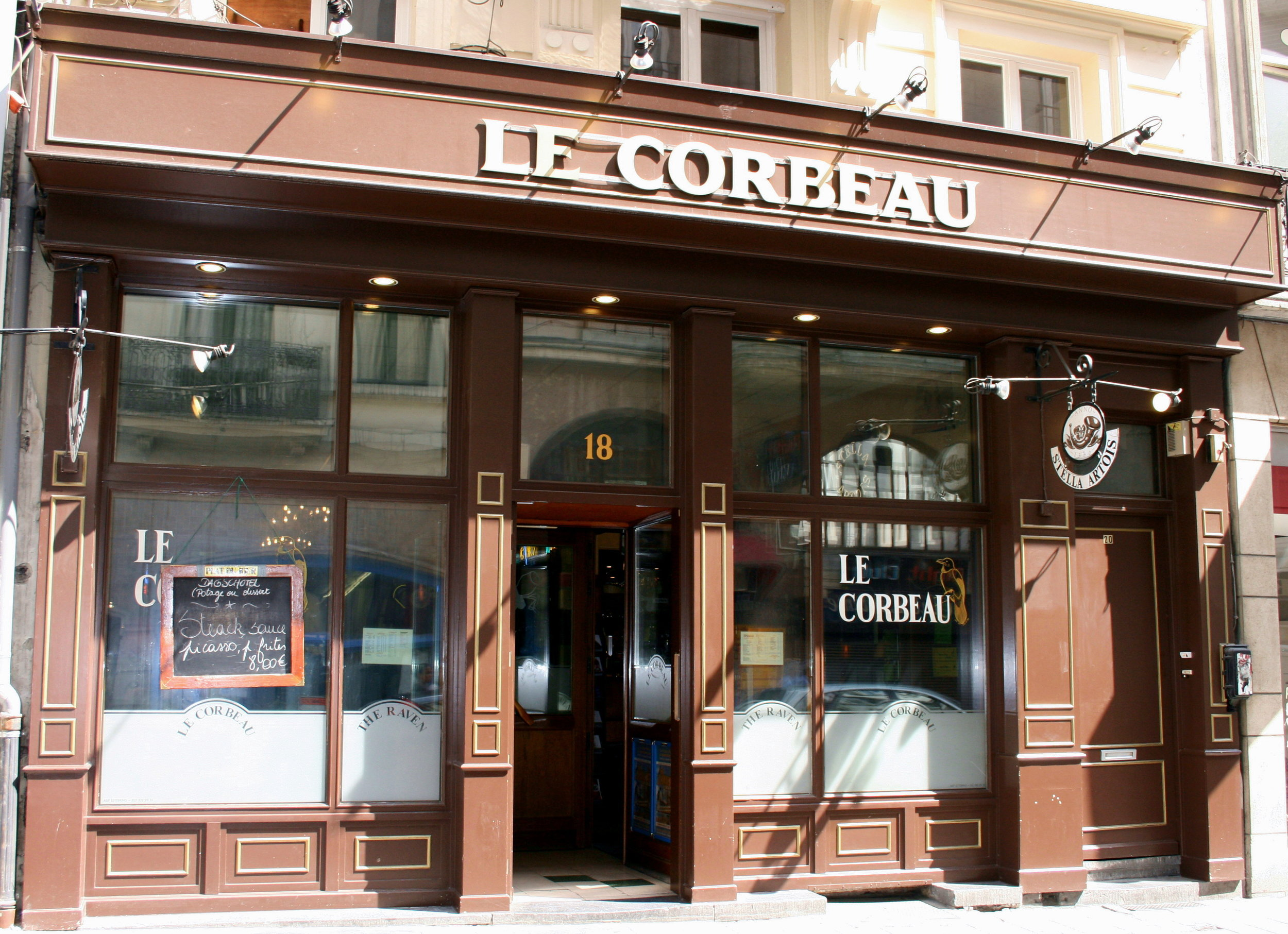 LE CORBEAU   http://www.lecorbeau.be     Unassuming from outside (difficult to find), really nice Belgian food (serve lunch till 2.30) and decent beer list (look out for the BIG glasses!) during day but at night they do live music/DJ and EVERYONE dances on tables, all ages and all types... it is great fun once you get into it. Also worth noting how, at night, the bar works with one person taking all orders and one other doing all drinks.