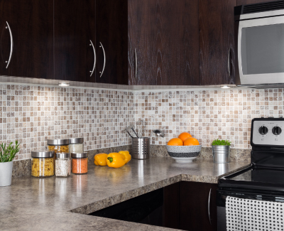 Kitchen with upgraded appliances and tile backsplash