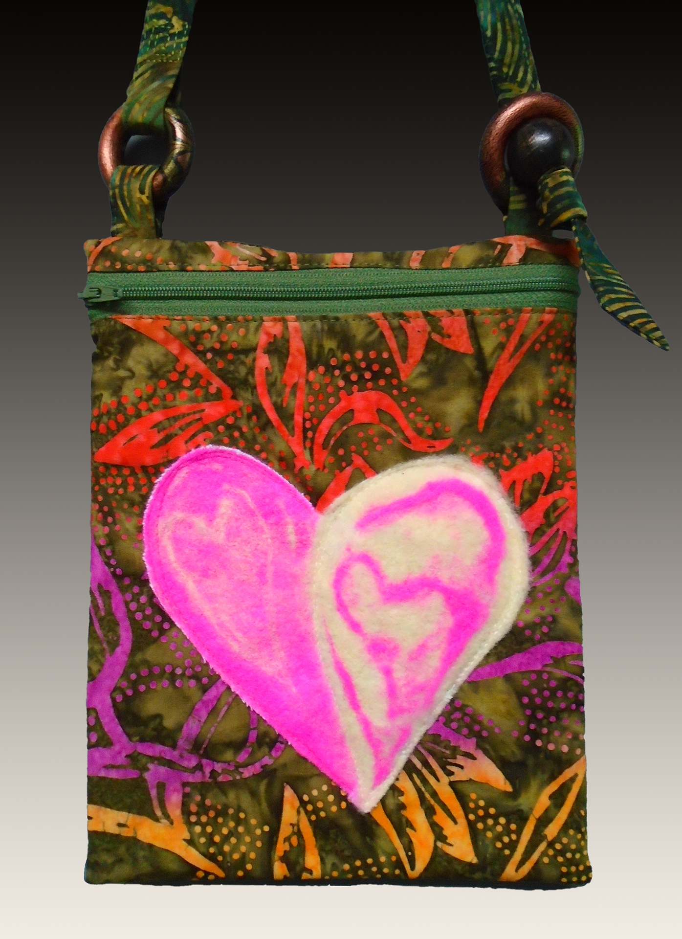Bold hand-felted heart in pink and white on front of bag