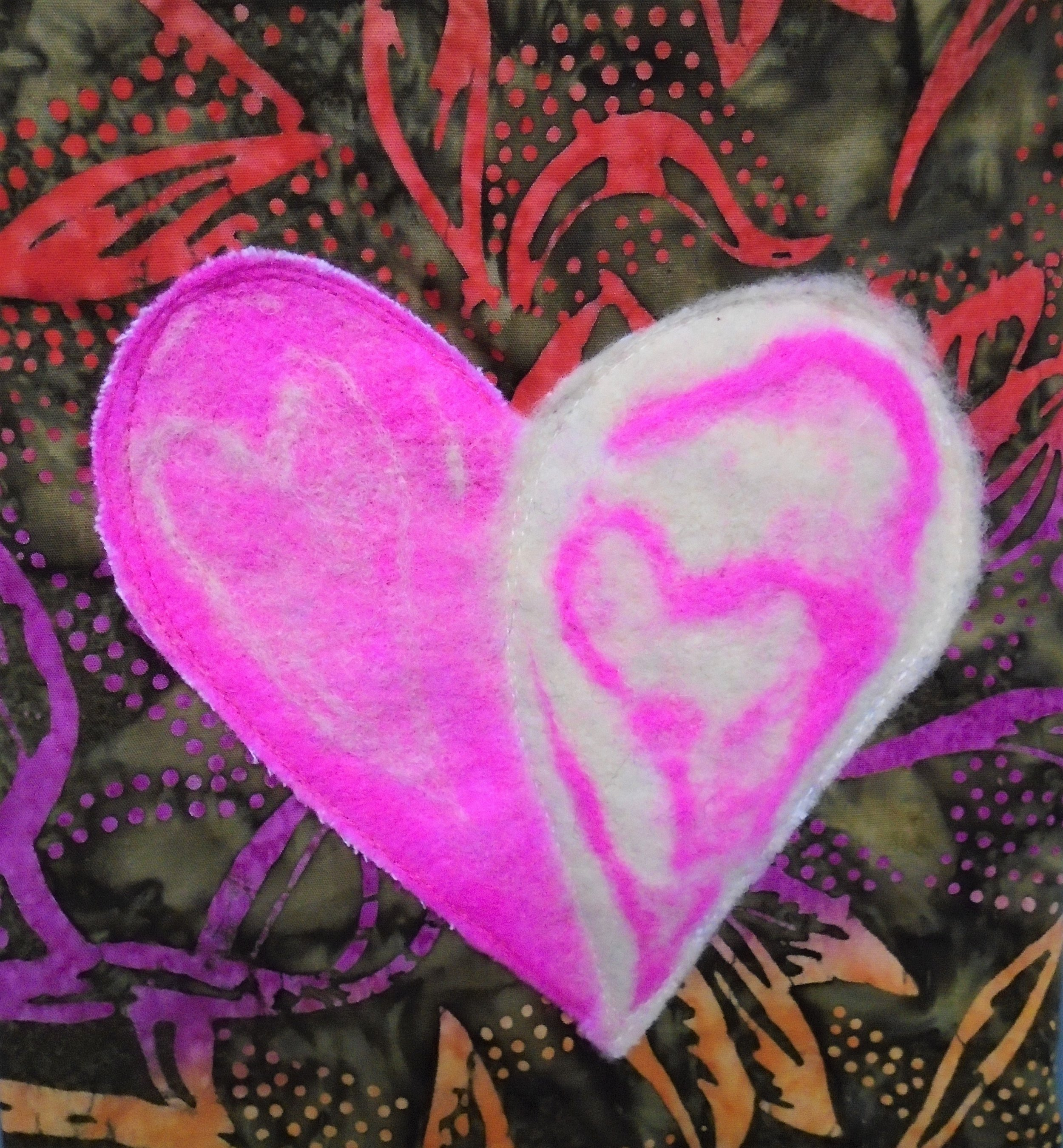 Close-up view of bag's hand-felted heart