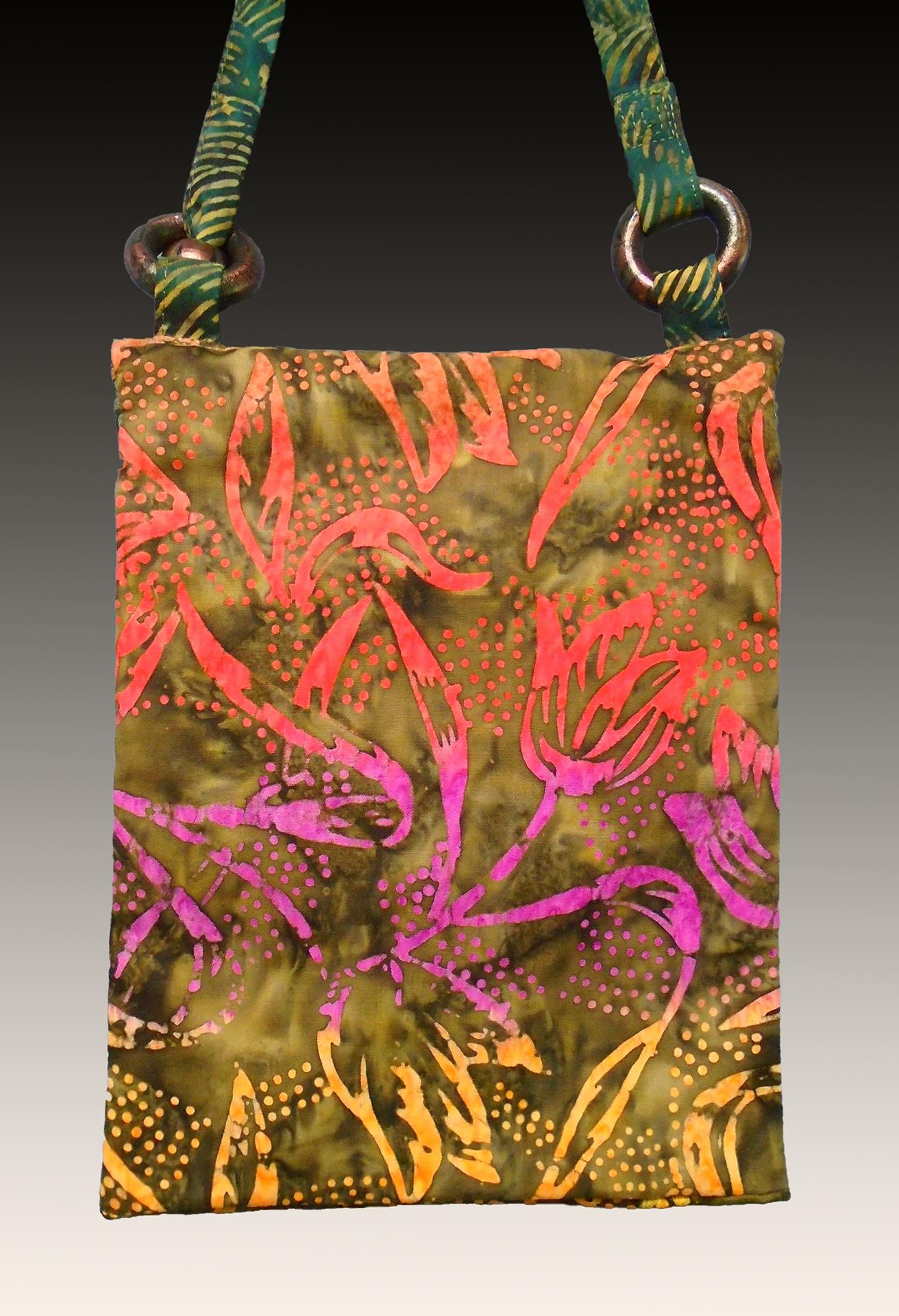 Reverse view of zippered bag showing Indonesian tulip batik
