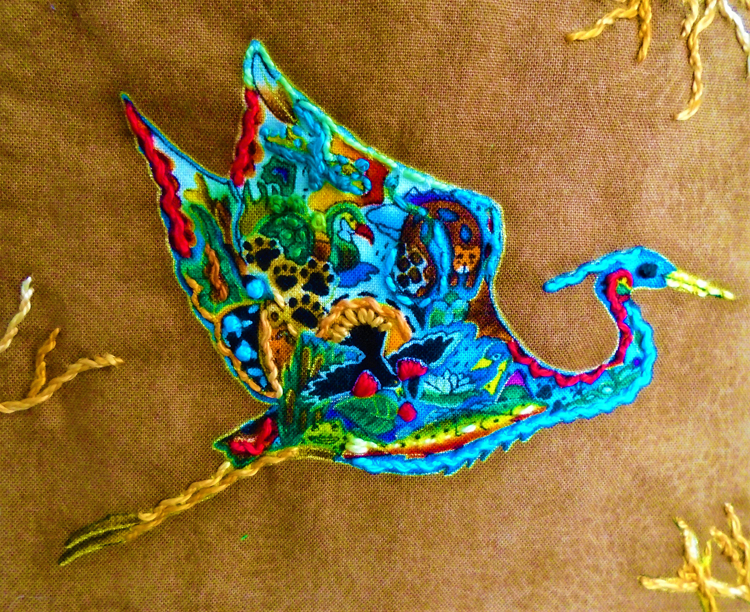 Detail of embroidered heron motif shows the the tiny patterns that comprise it