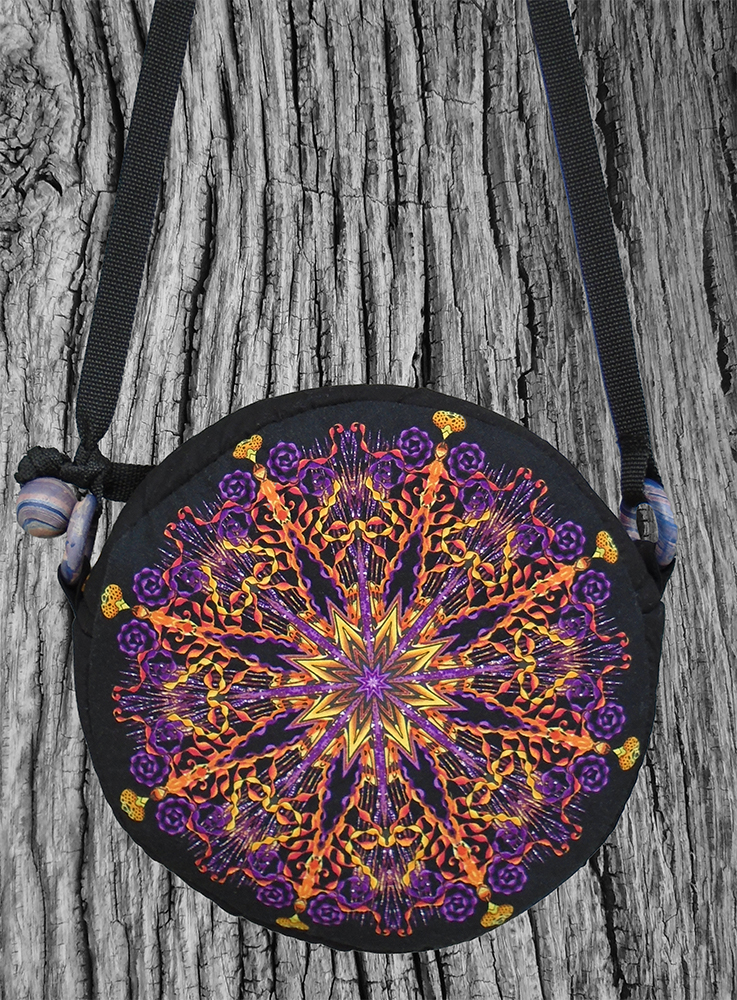 round, zippered, handmade bag with circular print in purple, gold and black