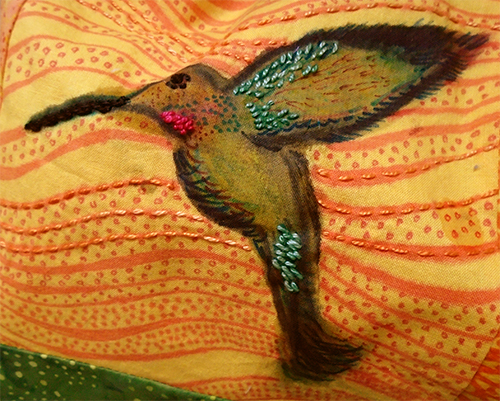Hand-painted hummingbird on hand-dyed background with embroidered highlights