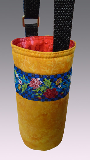yellow crossbody water tote trimmed by flower-patterned woven jacquard ribbon