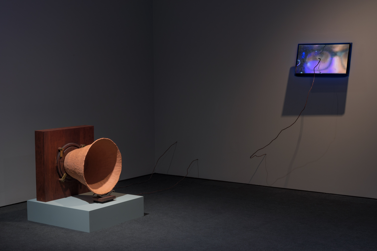 Conduct Matters, Hammer Project, Hammer Museum, Los Angeles. Visible:  Matter-phone , 2016, Terracotta, wood, metal, and copper wire, 25 x 24 x 21 inches, wire variable.;  Ground , 2017, hand-cast glass, copper wire, HD video (color, sound), and monitor with wall mount, 19 x12 monitor extending about 16 inches out from wall.