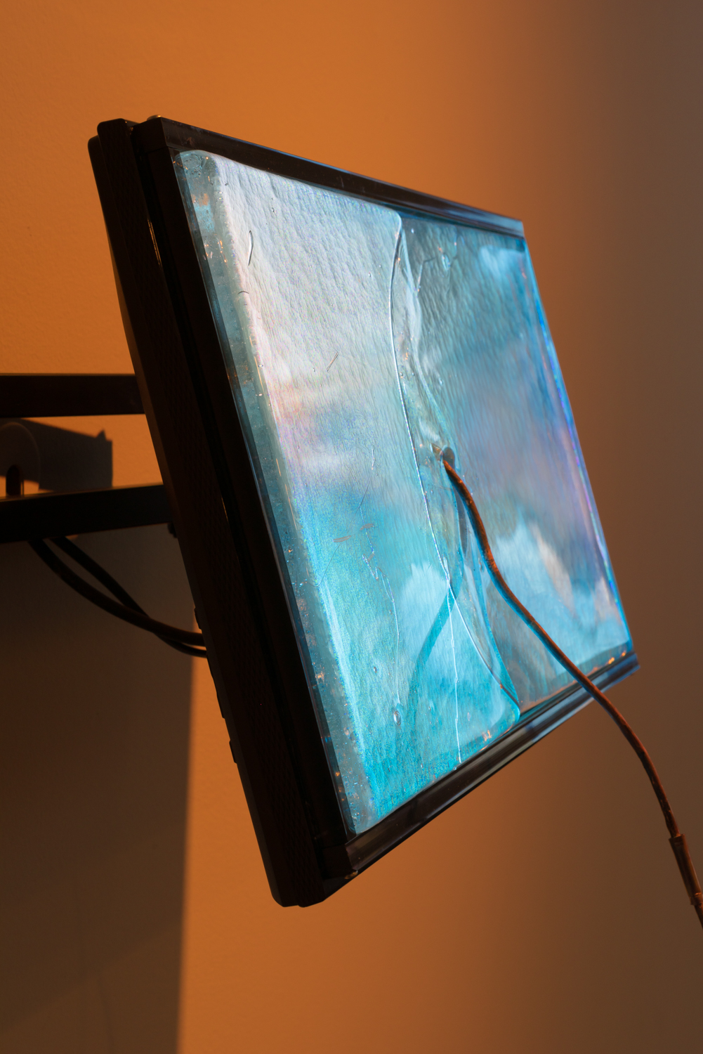 Conduct Matters, Hammer Project, Hammer Museum, Los Angeles. Visible: Ground, 2017, hand-cast glass, copper wire, HD video (color, sound), and monitor with wall mount, 19 x12 monitor extending about 16 inches out from wall.