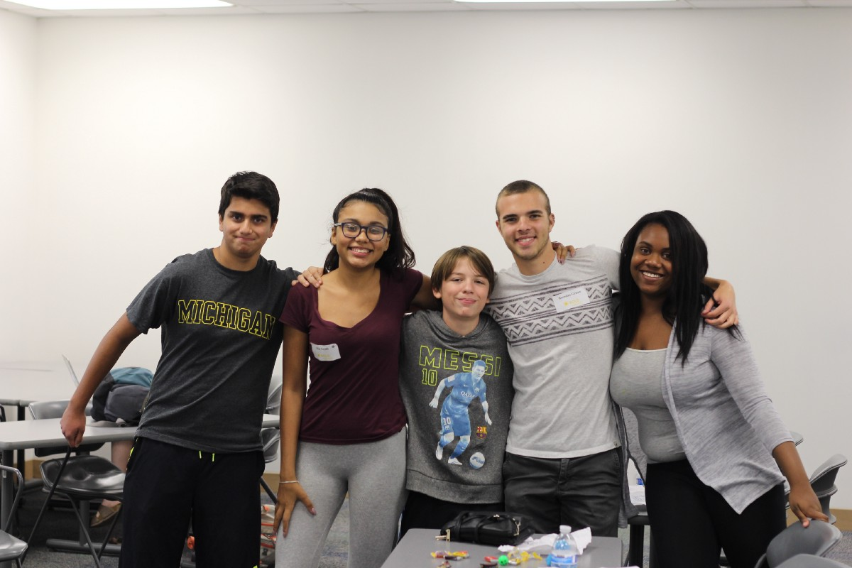 One of our facilitators, Brendan, with his team of high school students.