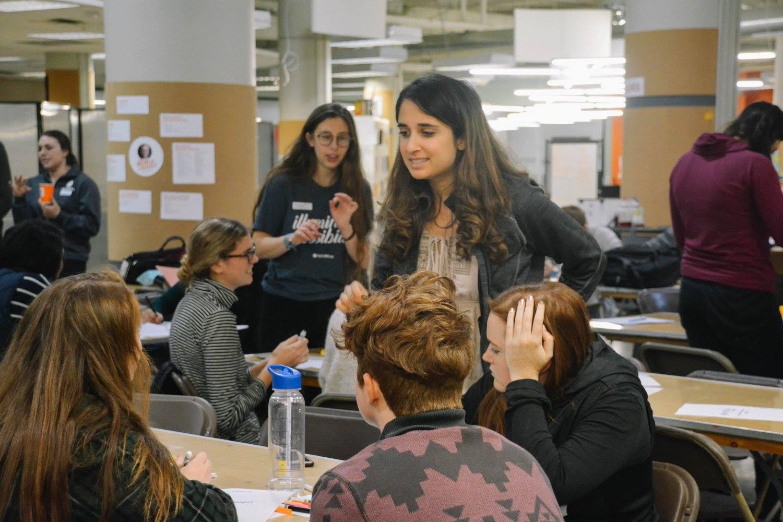 Parisa talks with optiMize participants at a Winter 2018 workshop