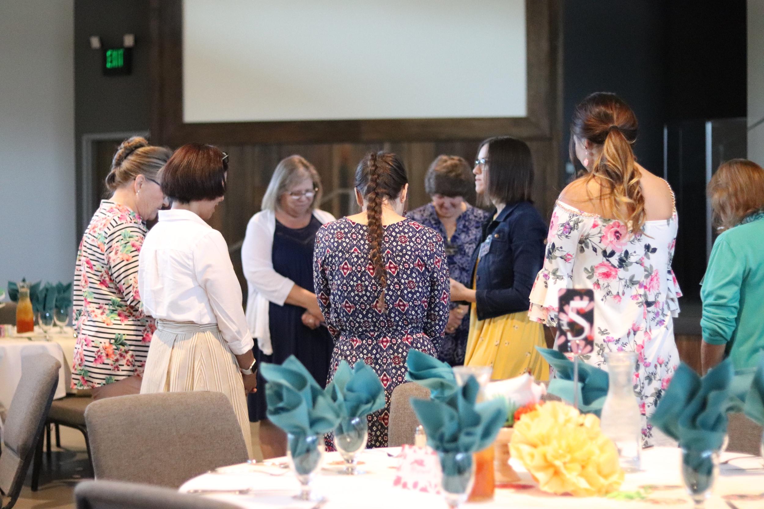 Women's Leadership praying