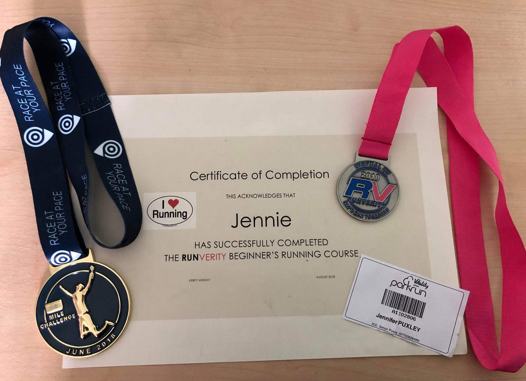 Jenni's certificate and medals