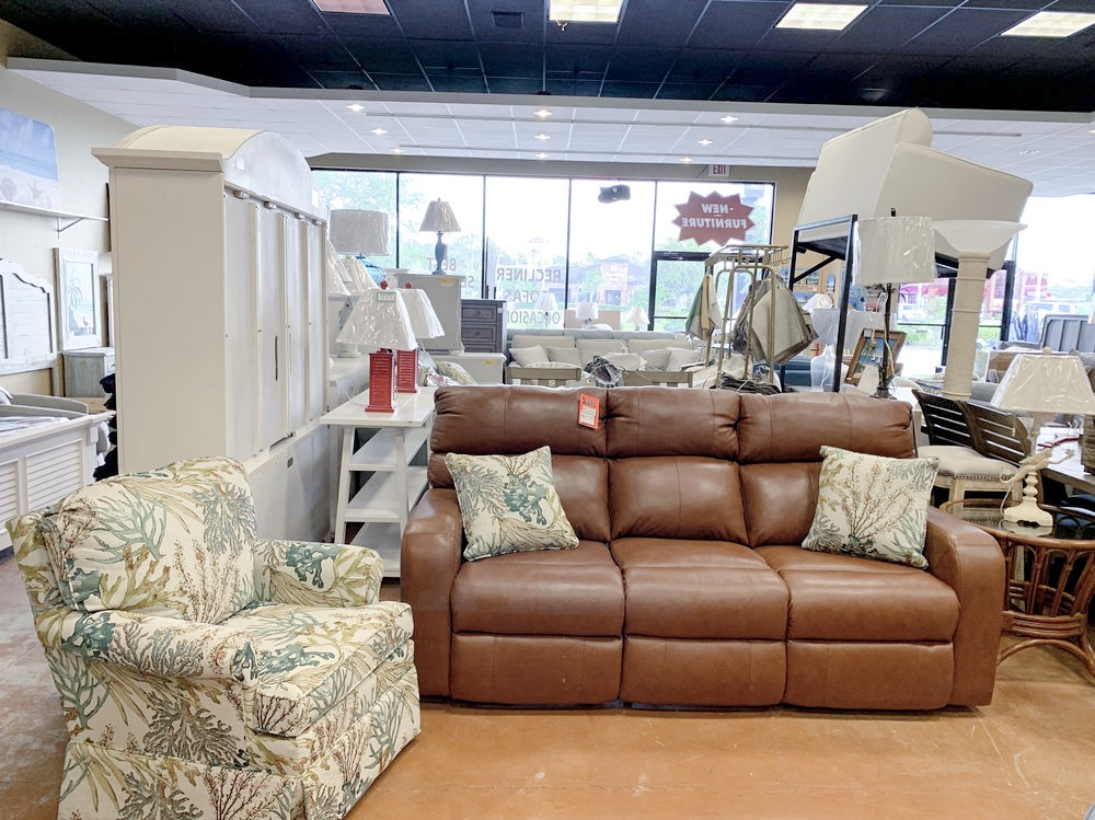 100% LEATHER RECLINING SOFA PAIRED WITH CORAL REEF CARIBBEAN ACCENT PILLOWS + QUINN SWIVEL ARM CHAIR