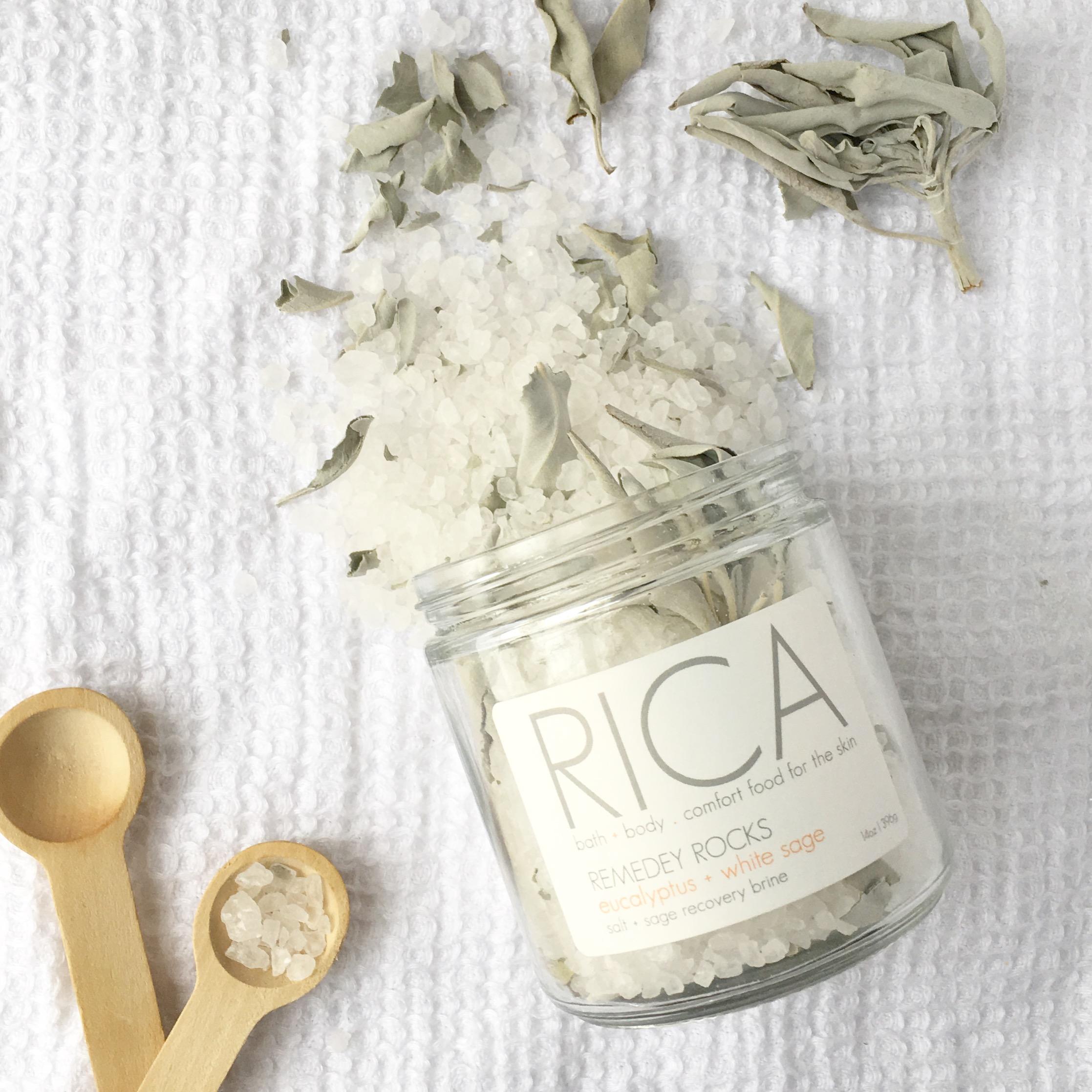 RICA bath + body Remedy Rocks Open jar with wooden scoops.JPG