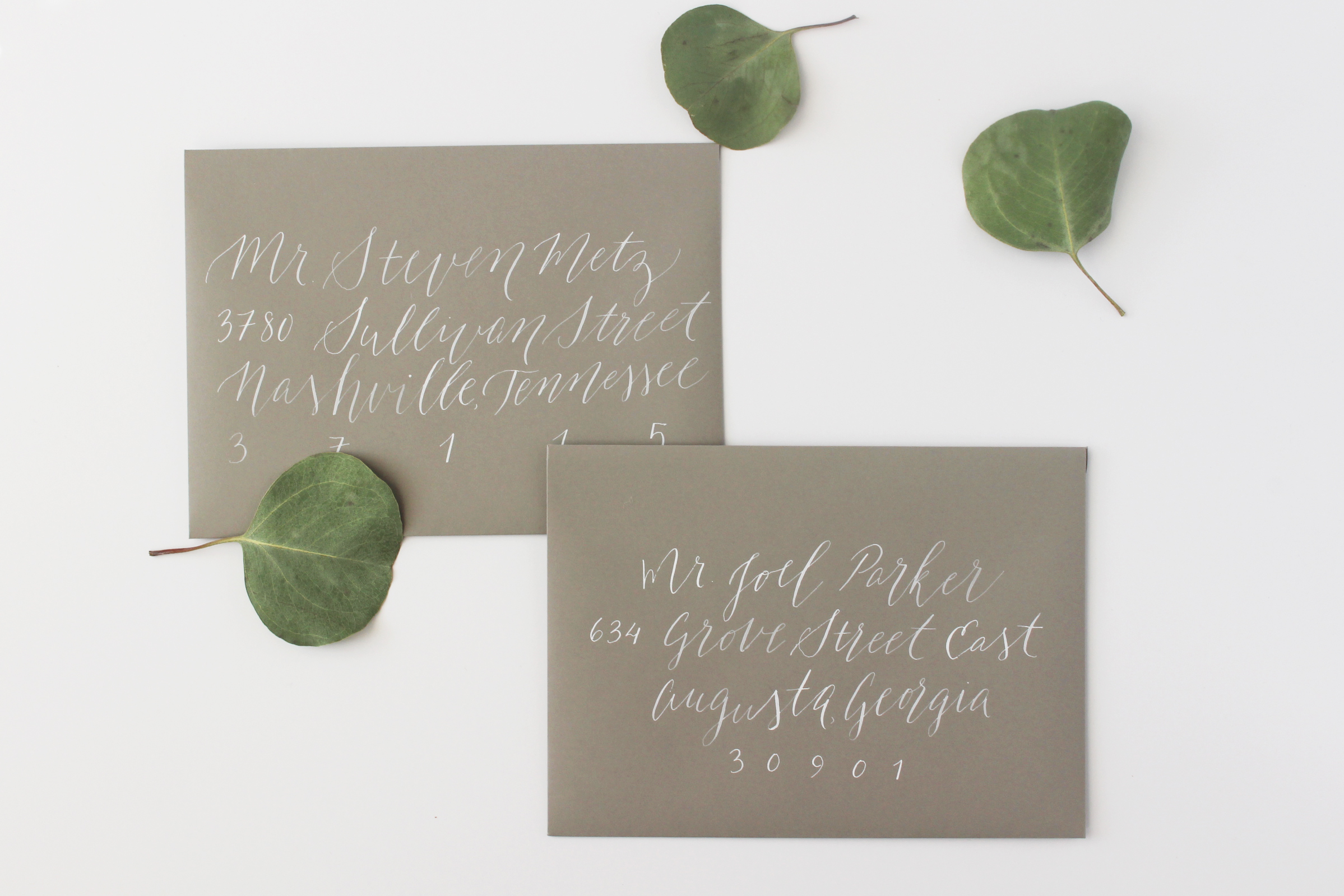White Ink Calligraphy on Grey Envelope
