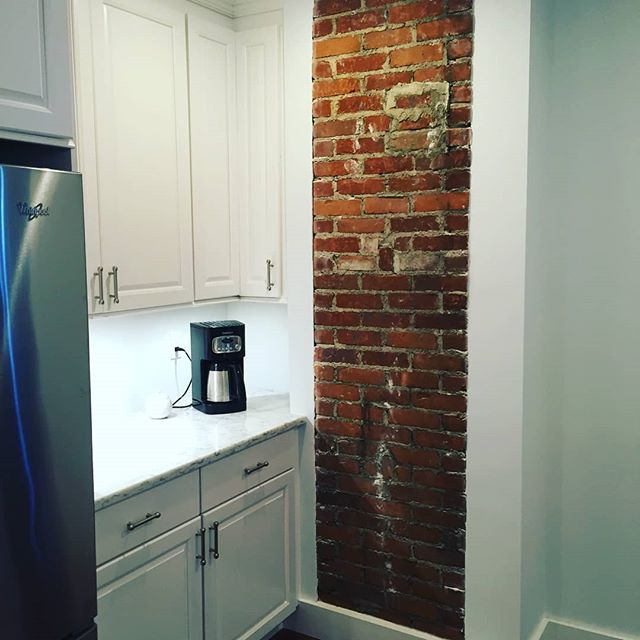 Exposed brick and coffee? Yes please! 😍 #kitchendesign #coffeenook #kitchen #remodeling #shawremodeling #countertops #whitecabinets #coffee #renovation #recessedlighting #hardwoodfloors #remodelingcompany #ideasandinspiration #homeowners #makeitbeautiful #brick #masonry #exposedbrick