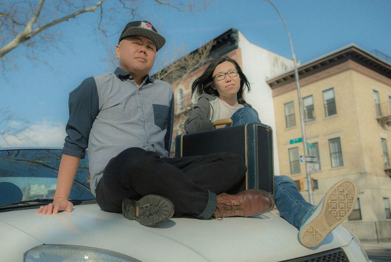 Kit and Melissa on white Kia.jpg