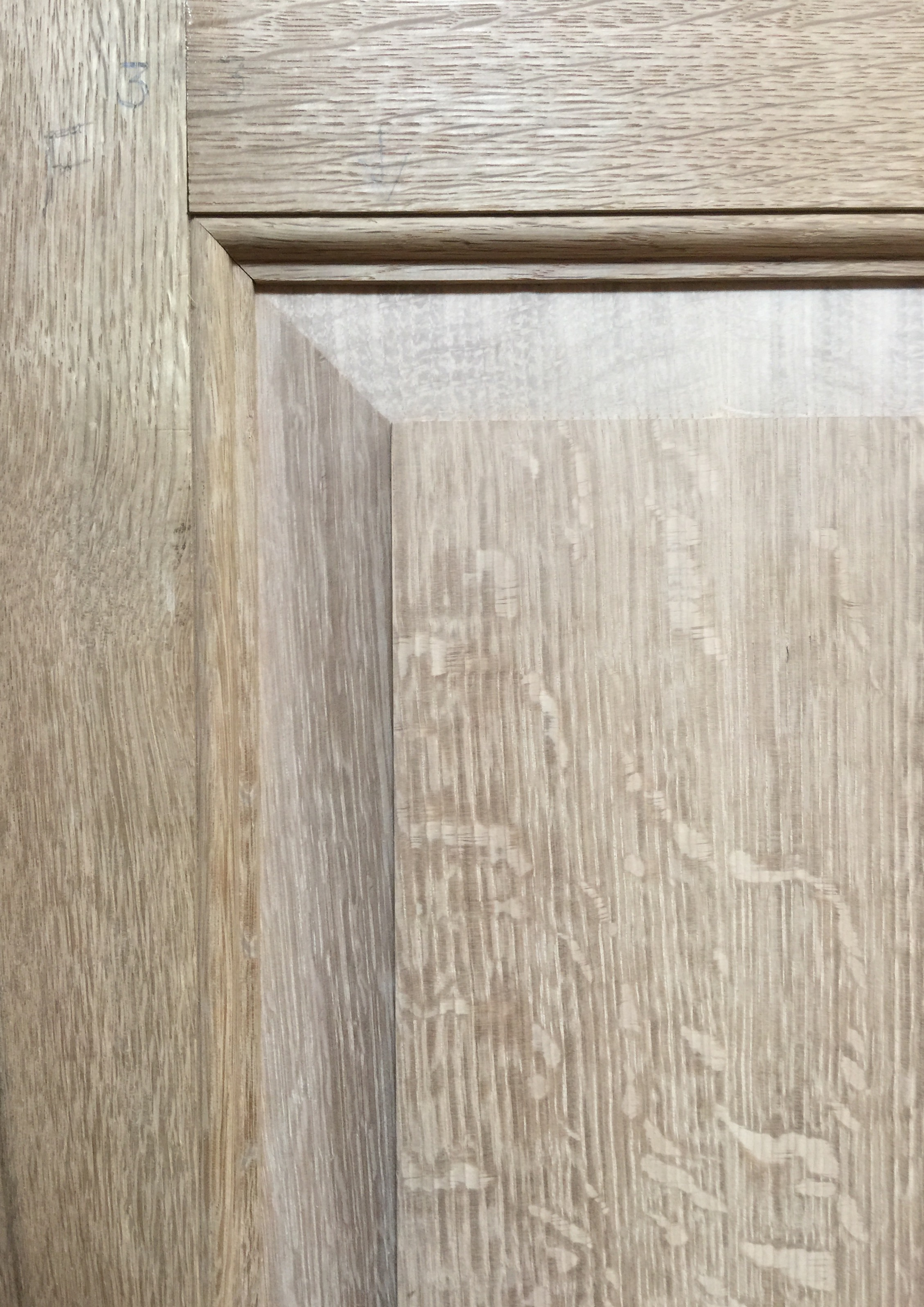 Frame and panel detail of the bookcase showing nicely figured oak and moldings made to match the English chest that inspired this piece.