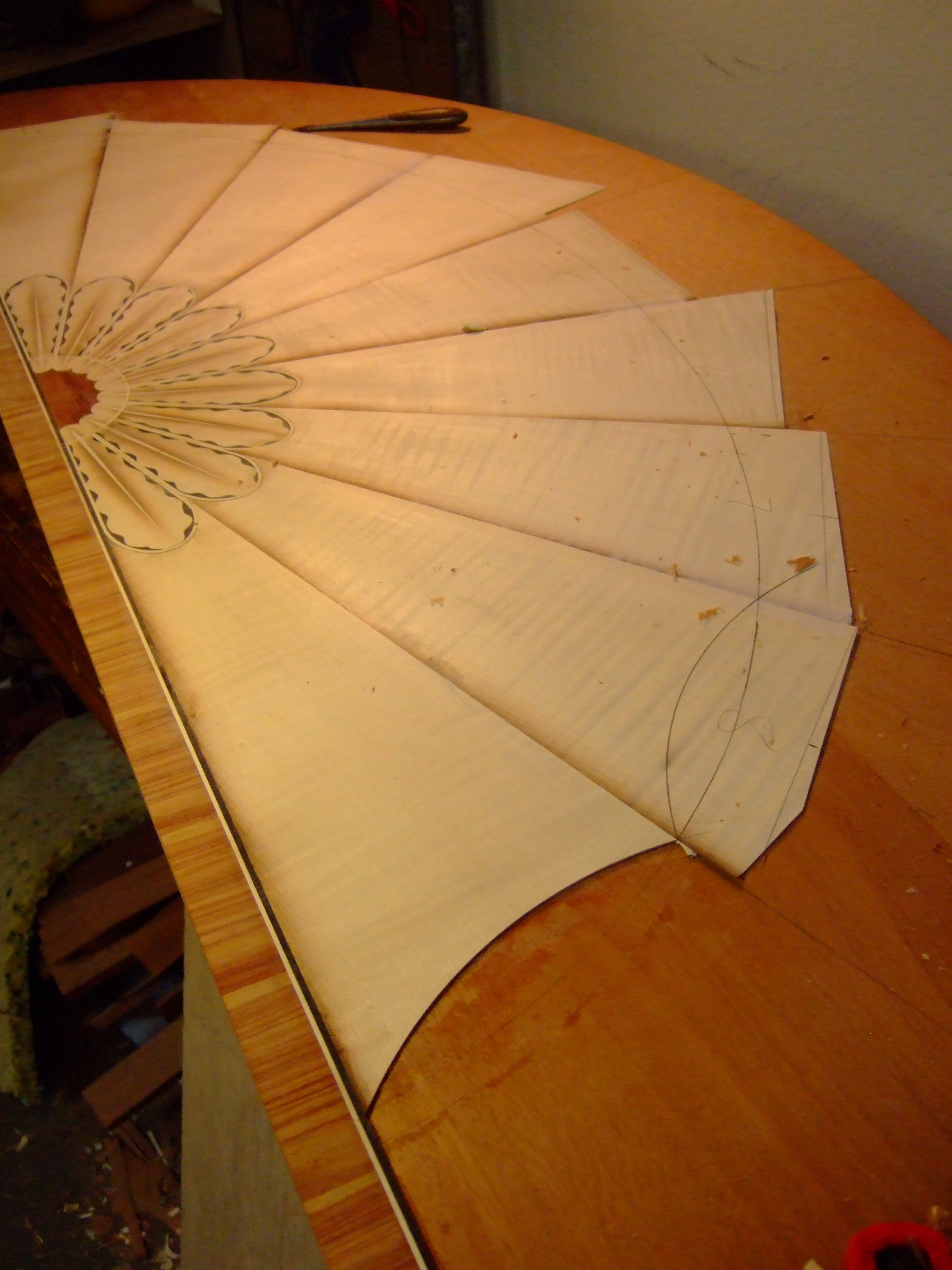 Shaping the sand shaded sycamore fan after veneering the pieces to the mahogany core.