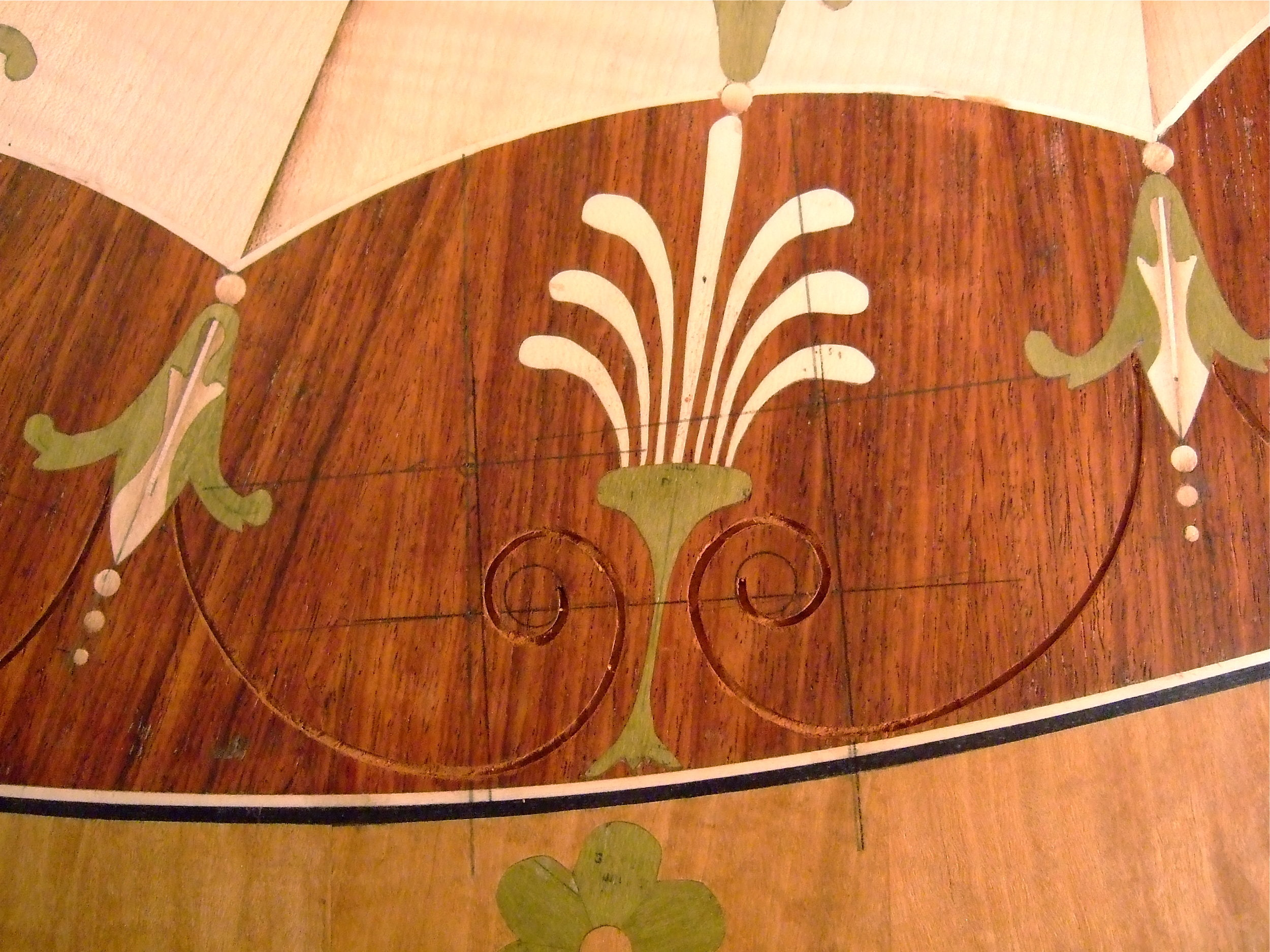Cutting the negative spaces for inlaying the volutes.