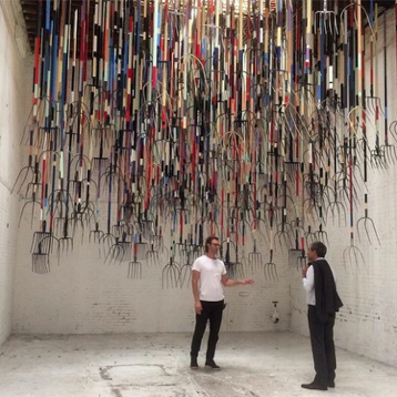 "Simon Birch and his pitchfork installation ""The Crusher"""