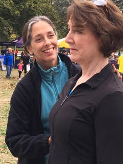 Diana Glenn gives an AT tune up to a care partner at the Parkinson's Foundation Moving Day® Boston in October 2017