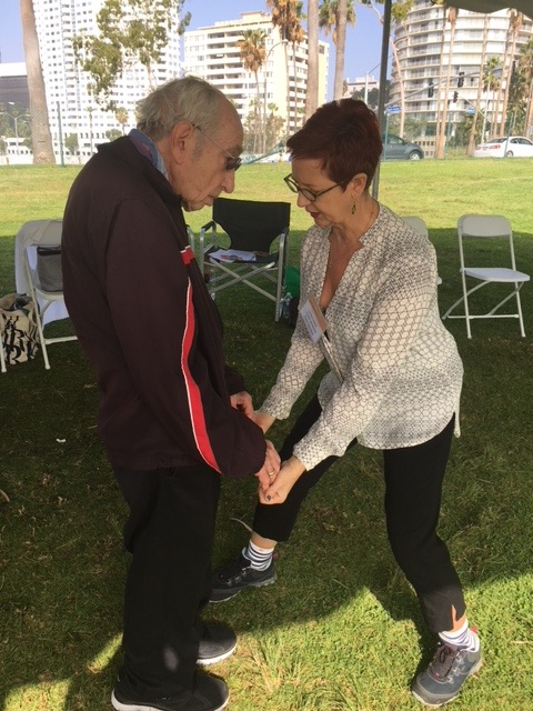Constance Clare-Newman gives a tune up to a PlwPD at the Parkinson's Foundation Moving Day® Los Angeles in October 2017