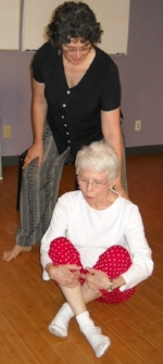 The Poise Project  Team Member, AT teacher Robbin L Marcus working with a student on getting on and off the floor with grace and ease.