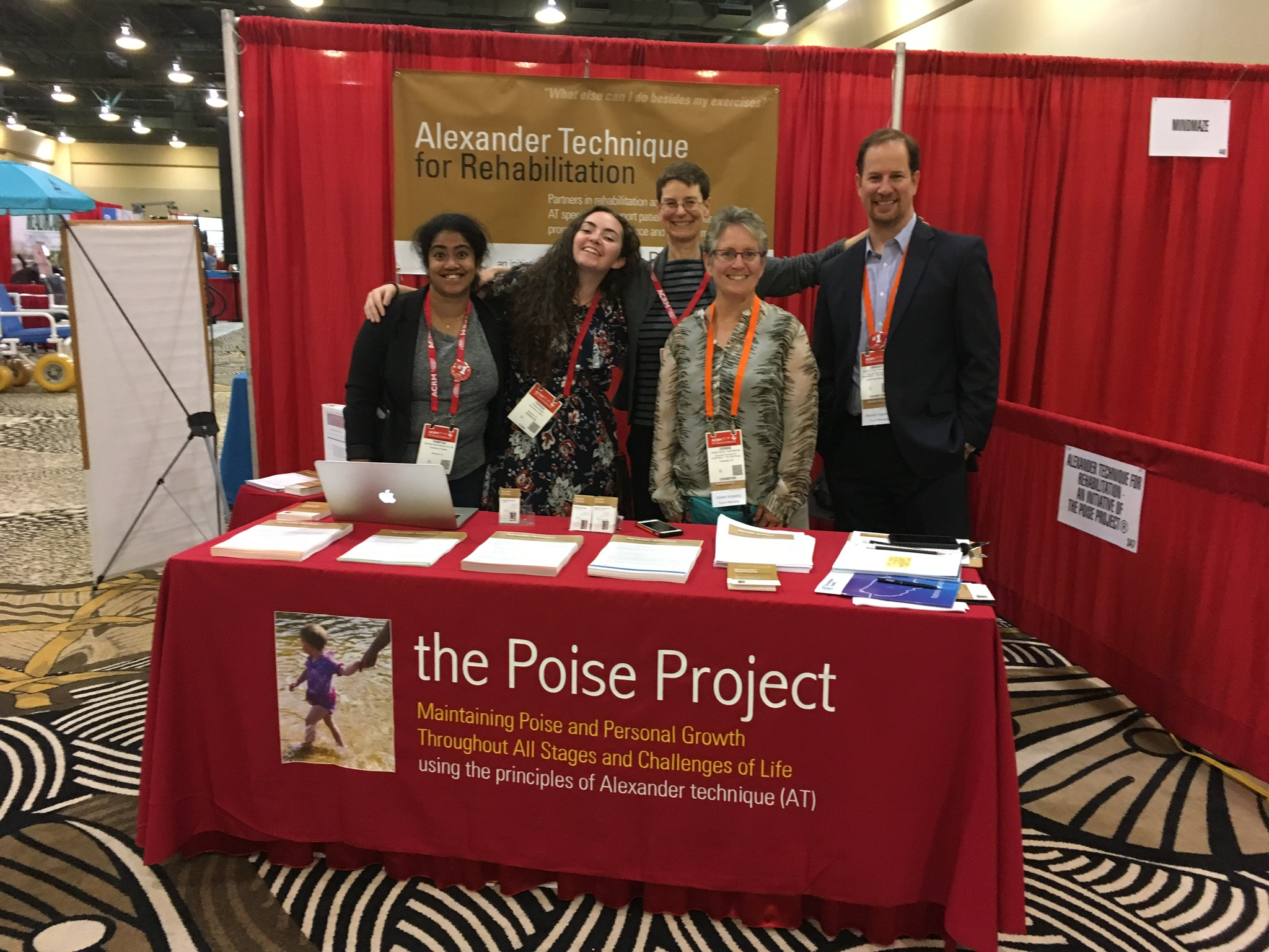 ACRM booth with Team Poise.jpg