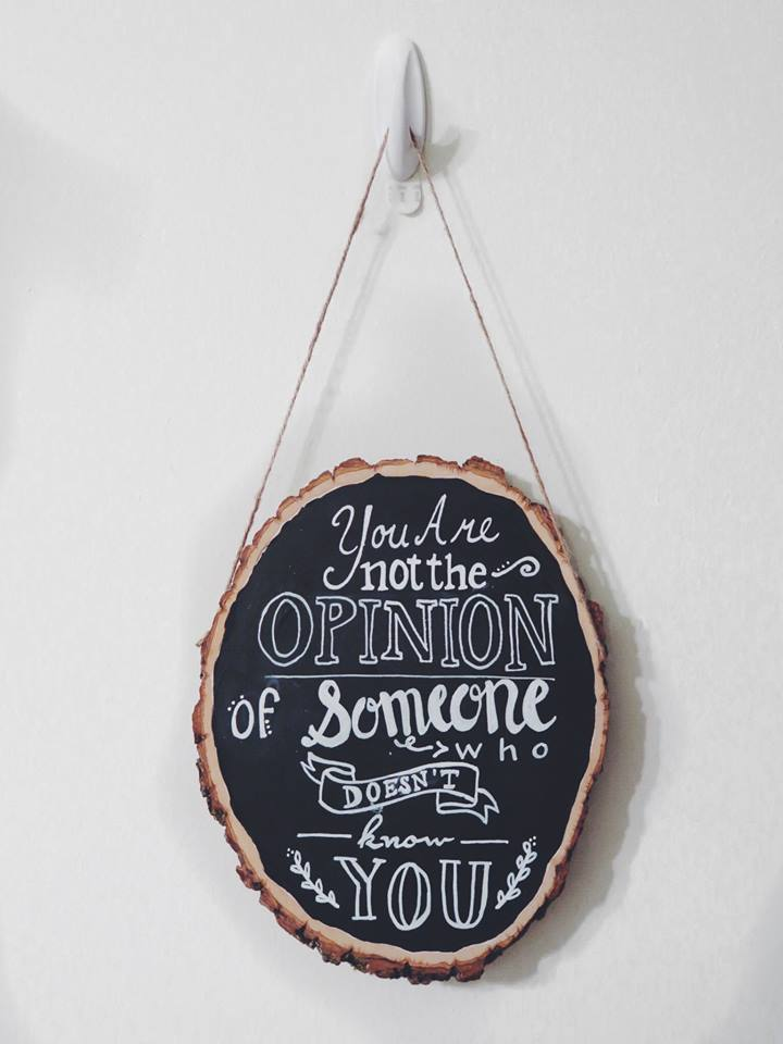 I made this using a wood slab I got from the craft store, chalk board paint, a chalk board marker, and nailing in a piece of twine on either side to hang it up.