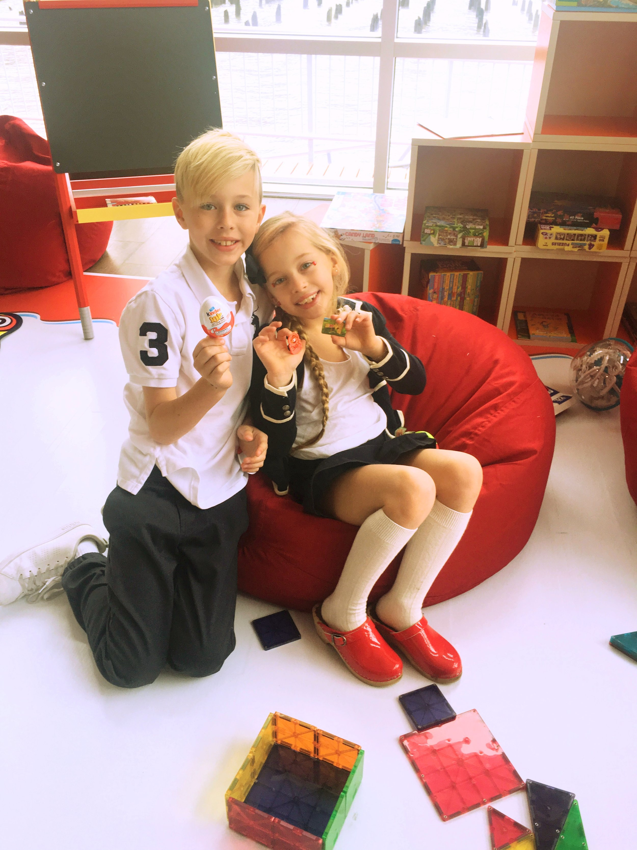 Brycen and Brinkley enjoying a special moment in the Kinder Kid Lounge