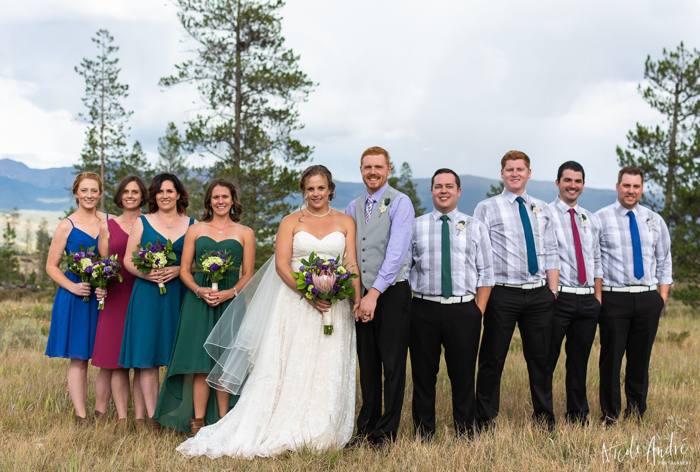 flying v bridal party photo