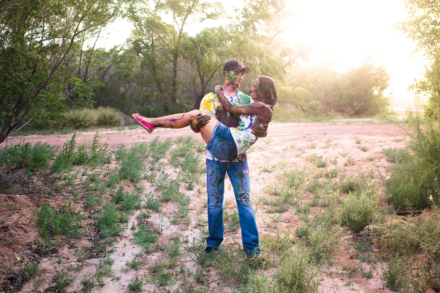 Couple alternative engagement anniversary photoshoot paint fight creative photographer Southern Utah