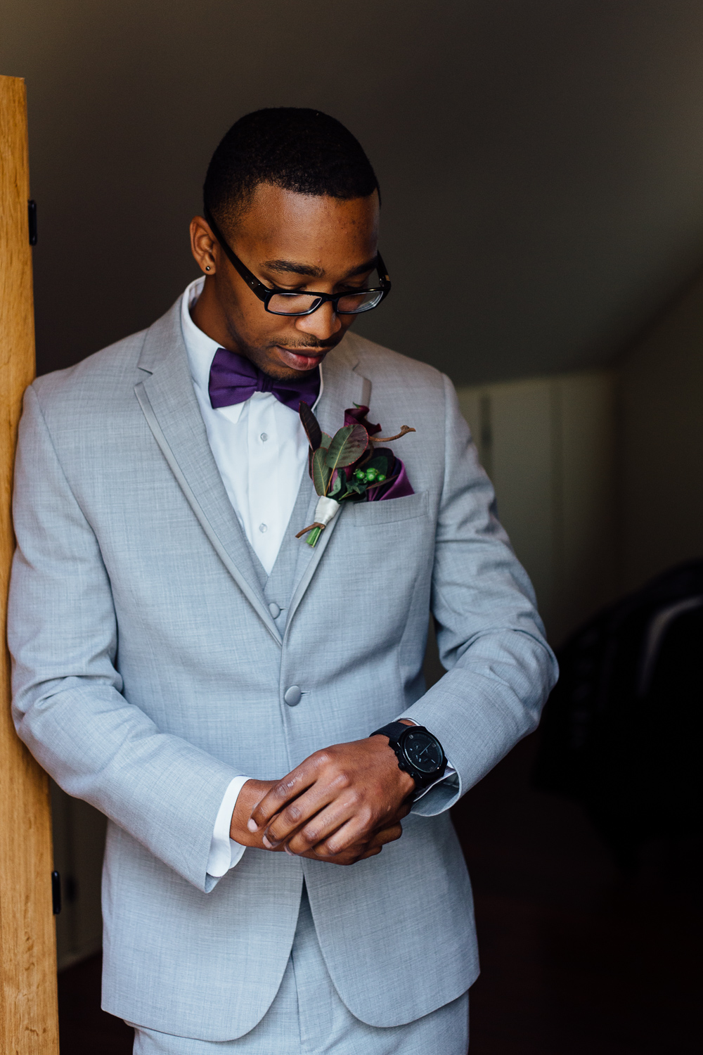Stylish African-American Black groom dapper gray suit