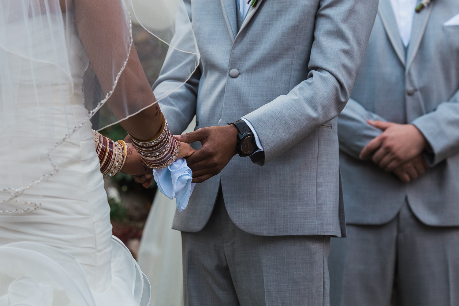 Intimate ceremony detail holding hands Utah wedding photographers