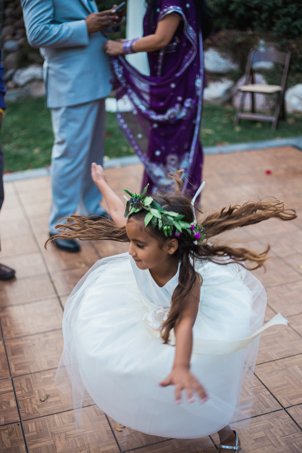 Twirling flower girl dance floor reception