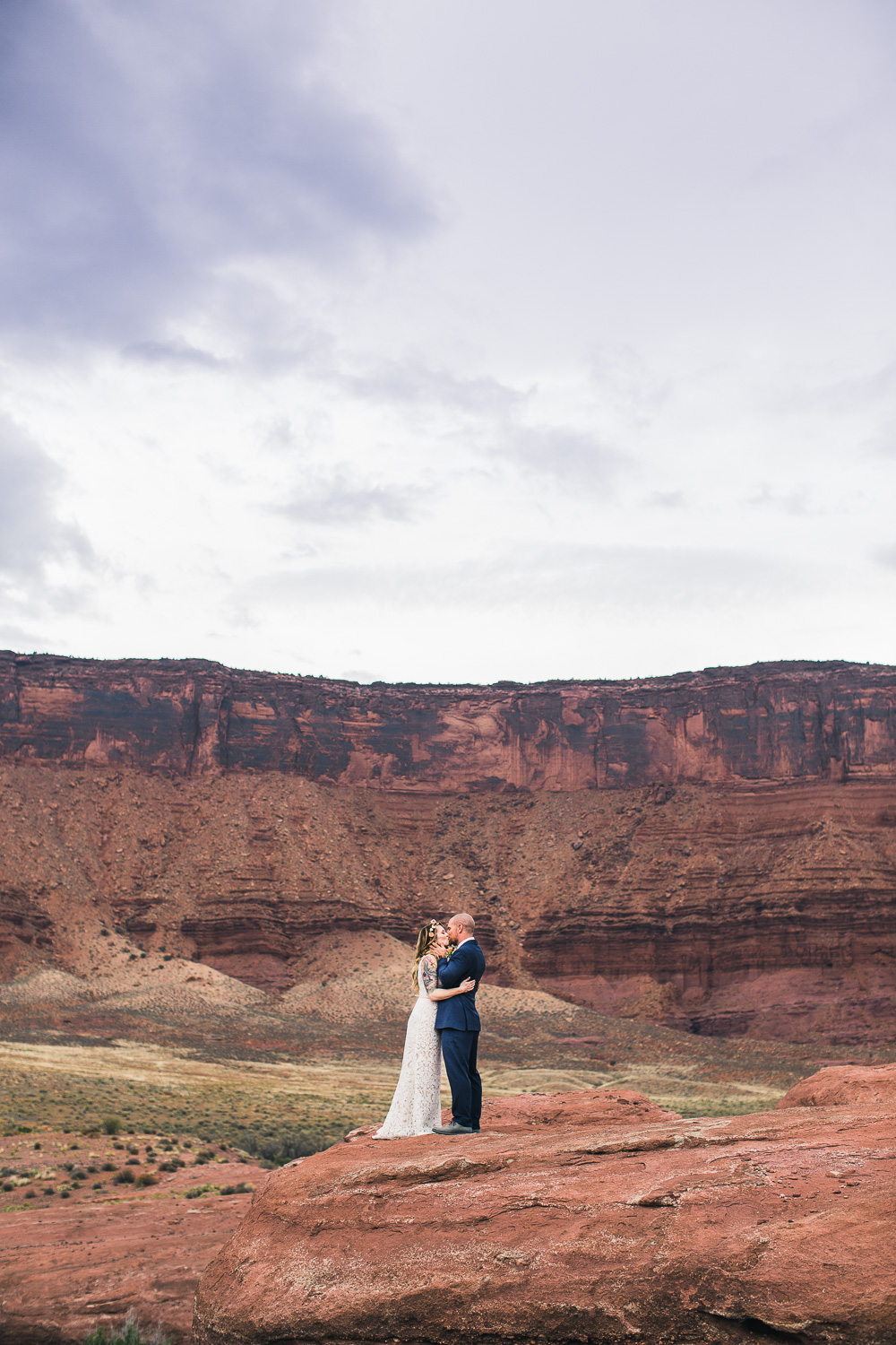 Fisher towers colorado river bride groom portrait Moab Utah