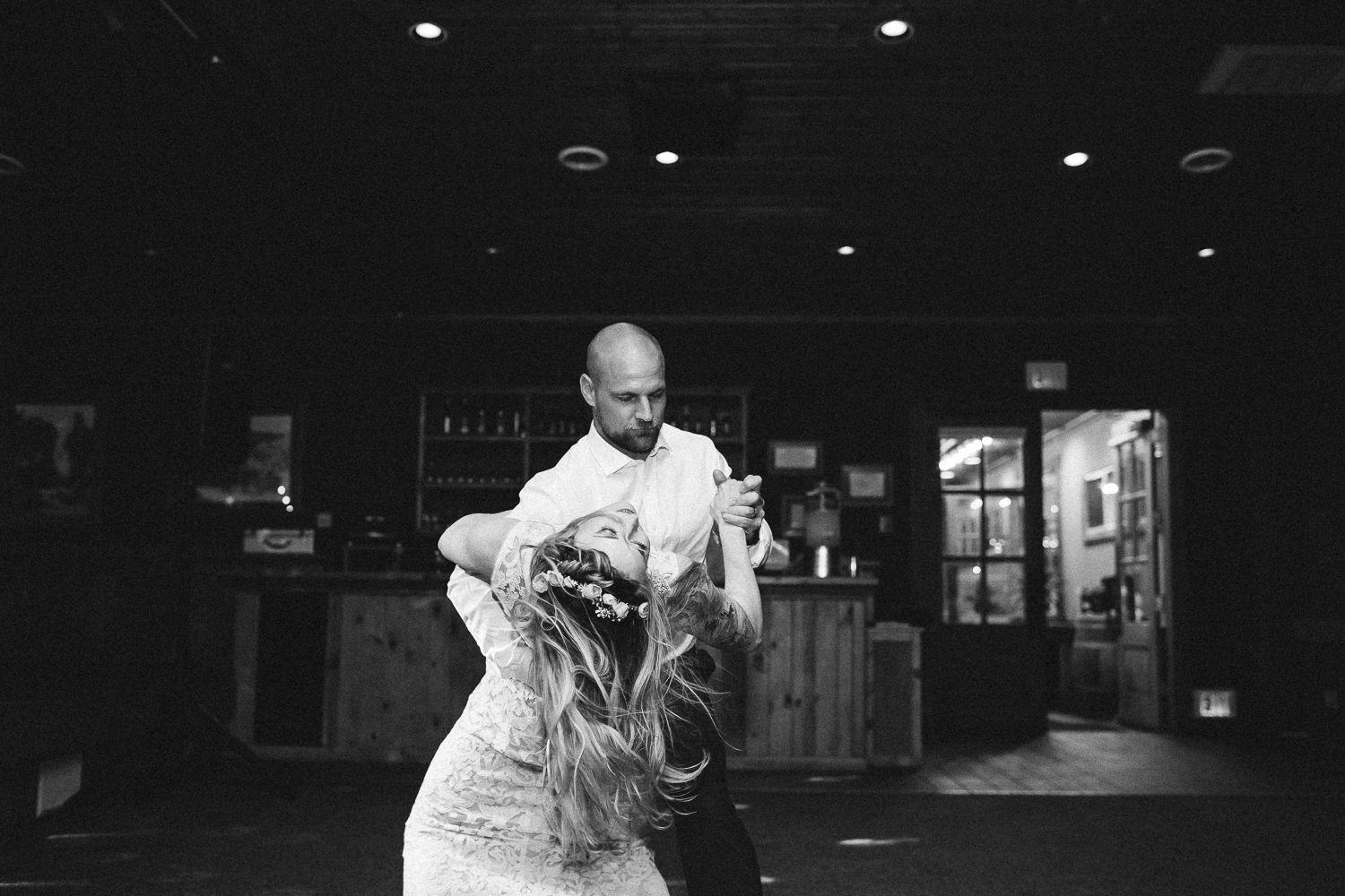 Bride and groom epic first dance dip black and white