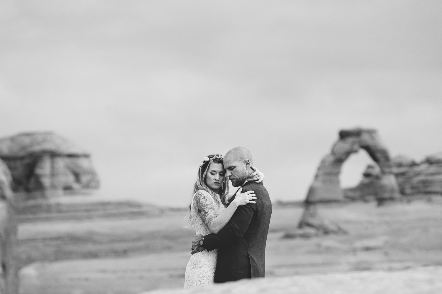 Delicate arch bride and groom wedding portrait black and white
