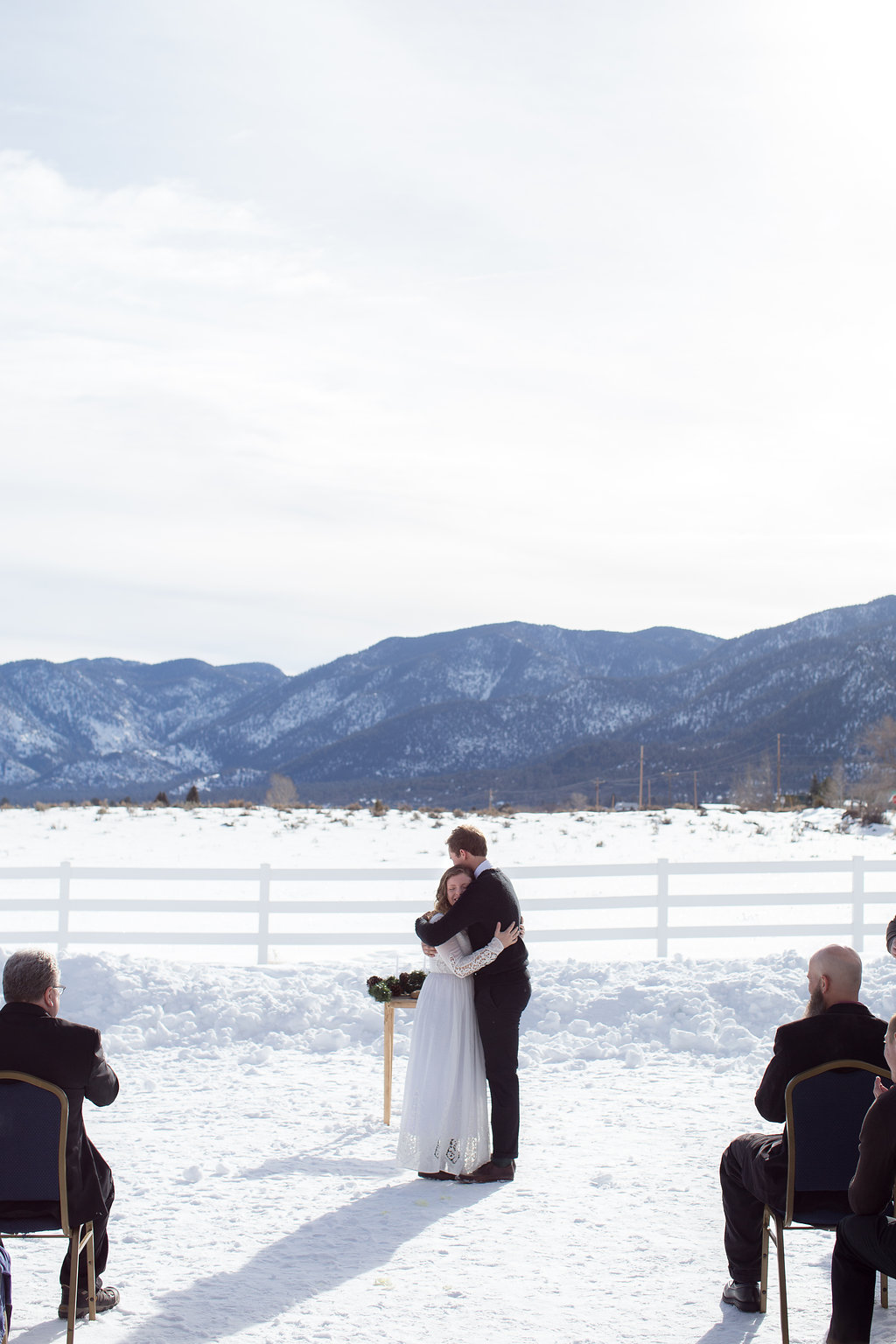Bride and groom embrace ceremony Pine Valley Utah