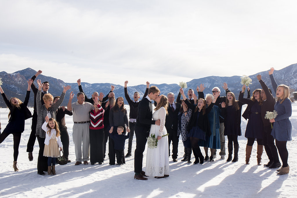 Bridal party kiss cheering mountain winter wedding photography