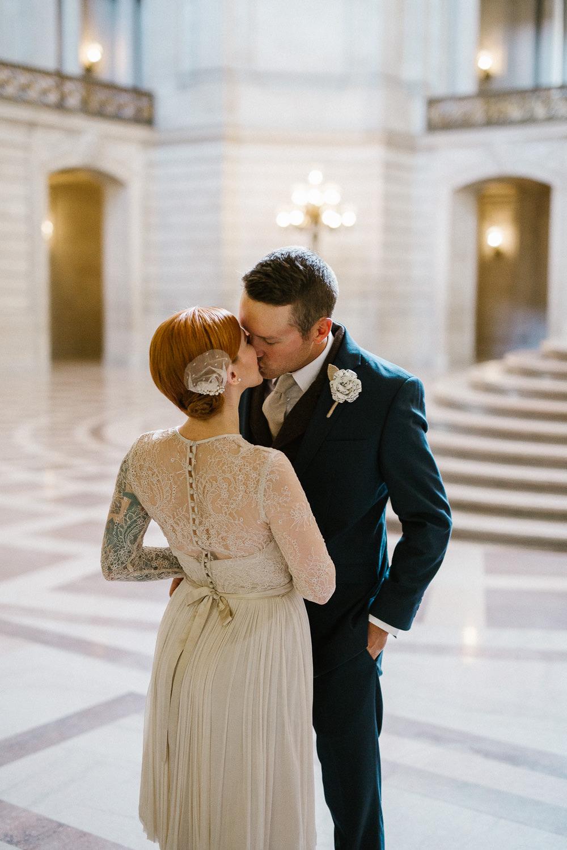 First look san francisco city hall wedding photographers Catherine Deane Waterfall Dress