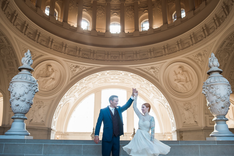 Tea-length wedding dress twirling portrait