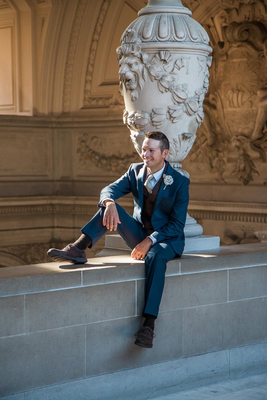 Handsome groom blue suit san fran city hall portrait