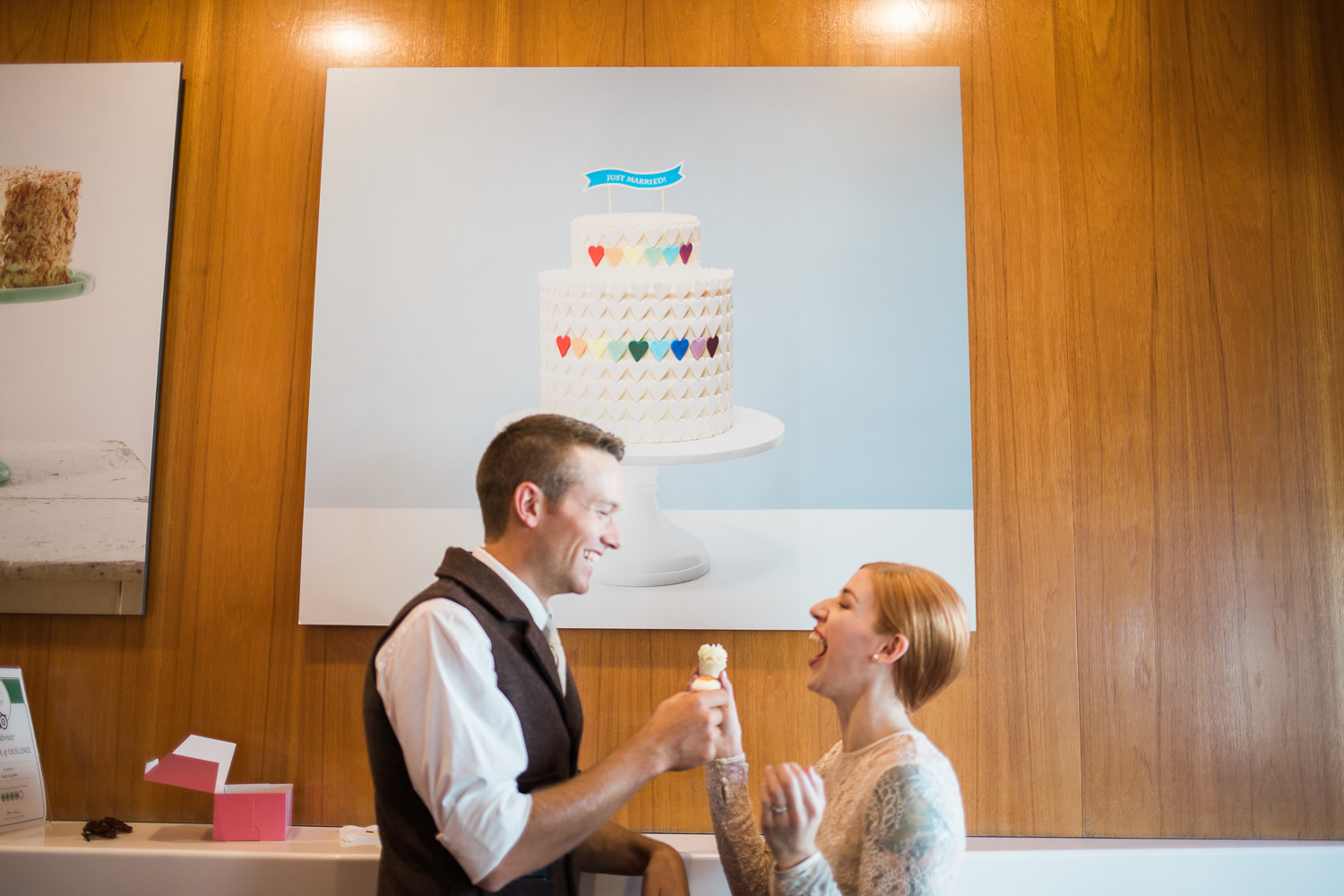 Bride and groom feeding cupcakes to each other unique wedding day