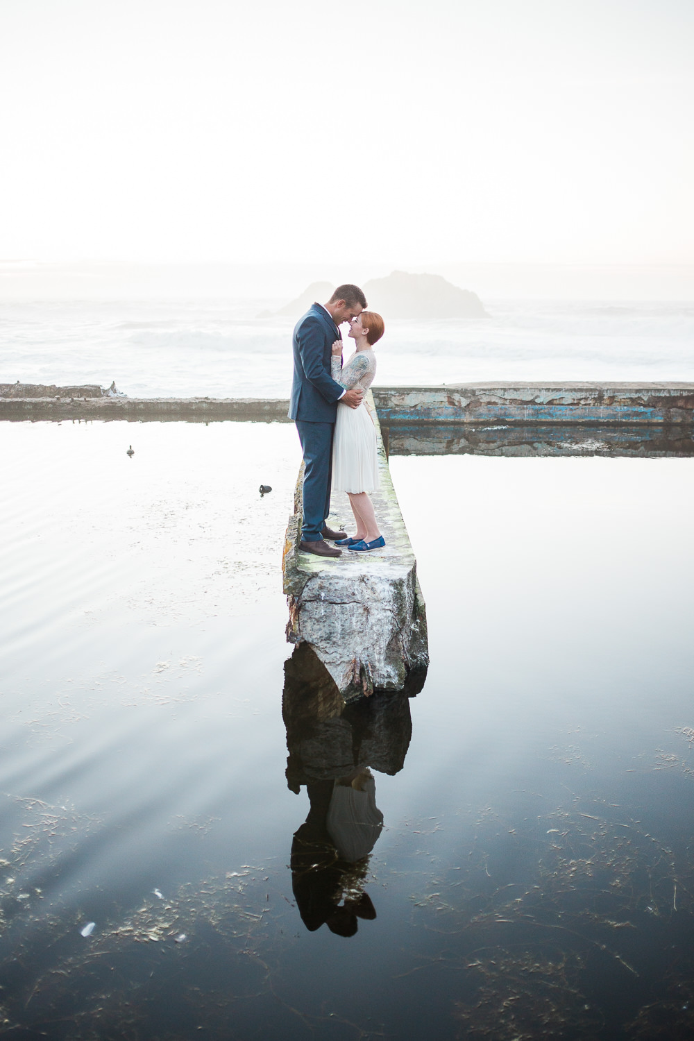 Beautiful Pacific Ocean reflection pool Sutro Baths wedding pictures Catherine Deane Waterfall Dress