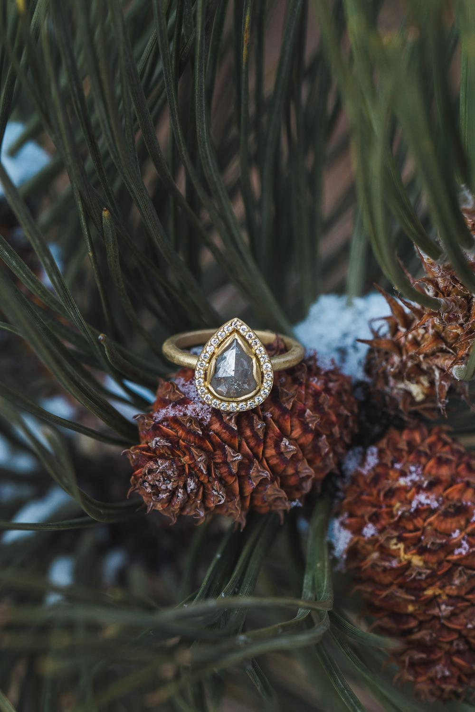 Metalmark House unique wedding ring and band Pine cone detail Colorado Photographer