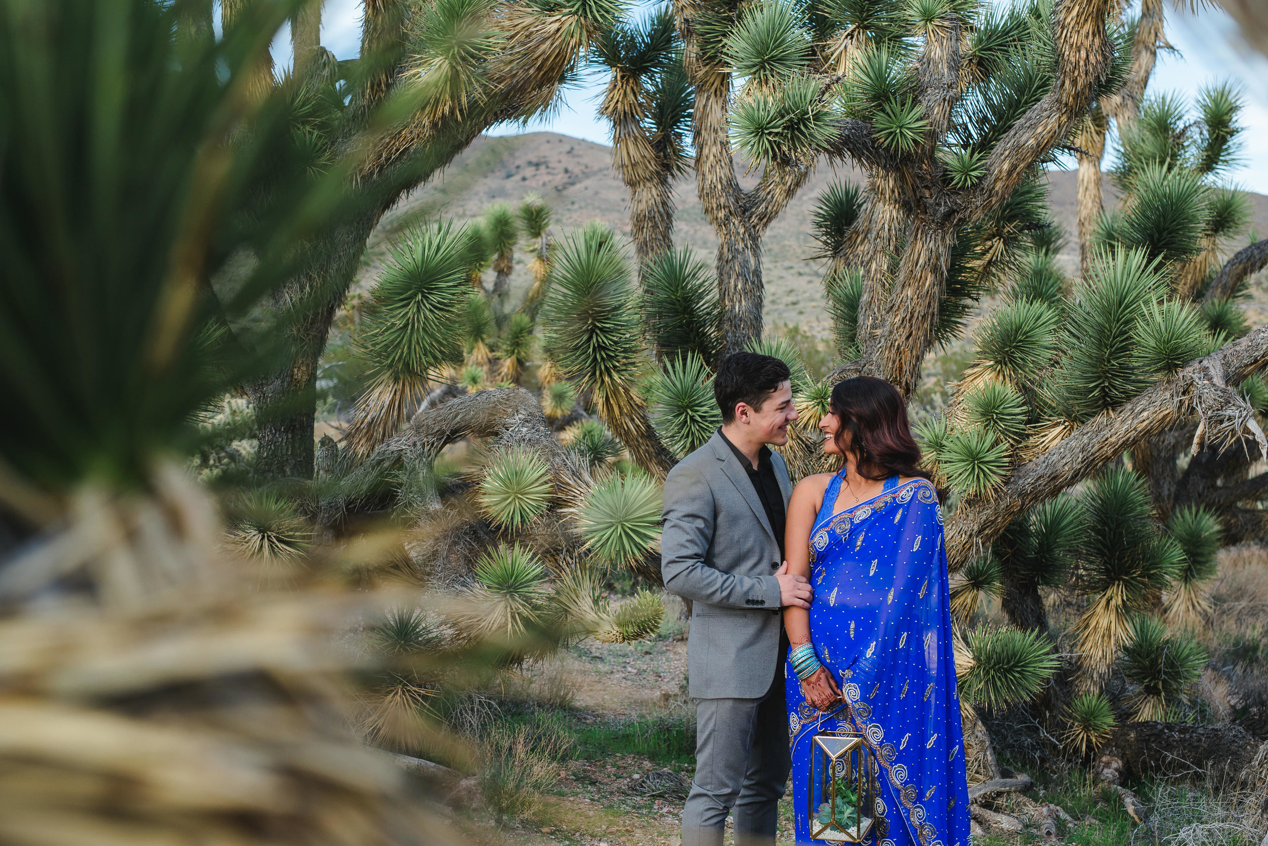 Ethnic Adventure elopement in Joshua Tree fields of Southern Utah Kyle Loves Tori Photography