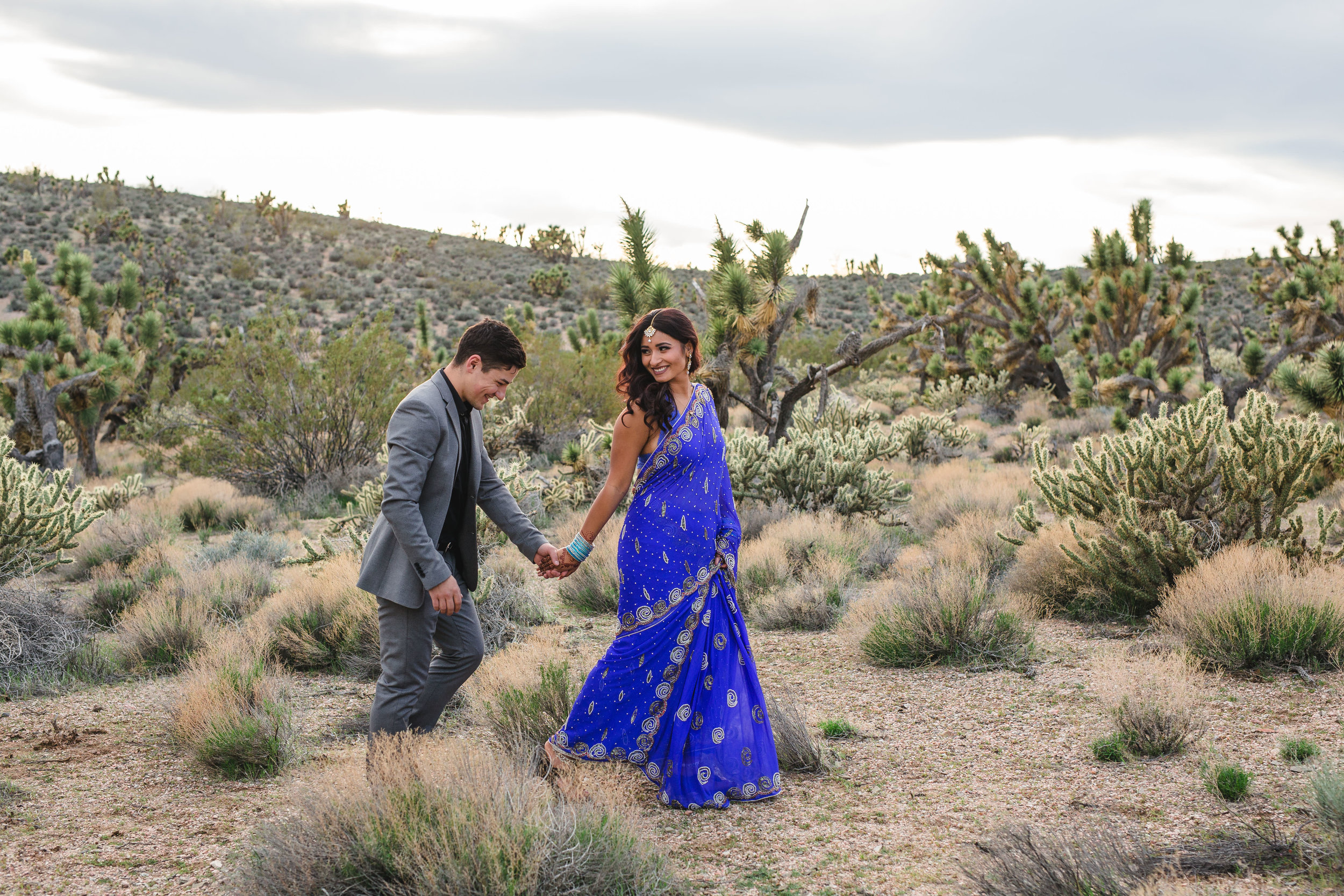 Happy couple walk in the desert Adventure Elopement Kyle Loves Tori Photography